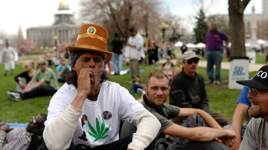 DENVER APRIL 19: J.D. from South Dakota is smoking marijuana during 420 Rally in Civic Center Park. Denver, Colorado. April 19, 2014.